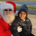 Santa and young boy at Twelve Points Tree Lighting